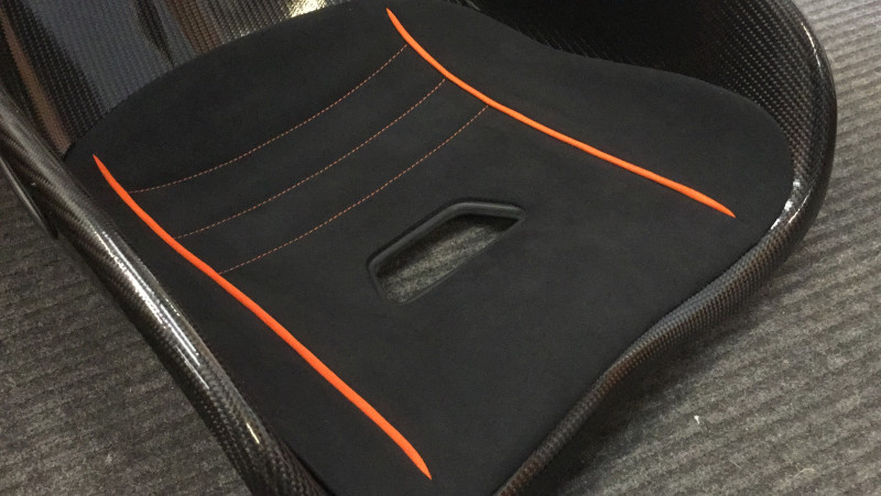 Tillett seat pad custom piping & stitching in orange